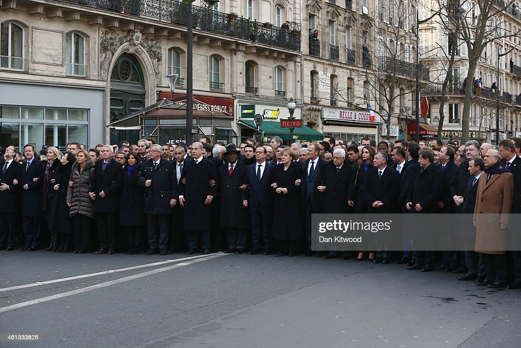 World leaders and dignitaries, including (L-R) Spanish Prime Minister Mariano Rajoy, British Prime Minister <a gi-track='captionPersonalityLinkClicked' href=/galleries/search?phrase=David+Cameron+-+Politiker&family=editorial&specificpeople=227076 ng-click='$event.stopPropagation()'>David Cameron</a>, Israeli Prime Minister Benjamin Netanyahu, French President Francois Hollande, German Chancellor <a gi-track='captionPersonalityLinkClicked' href=/galleries/search?phrase=Angela+Merkel&family=editorial&specificpeople=202161 ng-click='$event.stopPropagation()'>Angela Merkel</a>, Palestinian President Mahmoud Abbas, Queen Rania and King Abdullah II of Jordan and President of Ukraine <a gi-track='captionPersonalityLinkClicked' href=/galleries/search?phrase=Petro+Poroshenko&family=editorial&specificpeople=549382 ng-click='$event.stopPropagation()'>Petro Poroshenko</a> attend a mass unity rally following the recent Paris terrorist attacks on January 11, 2015 in Paris, France. An estimated one million people have converged in central Paris for the Unity March joining in solidarity with the 17 victims of this week's terrorist attacks in the country. French President Francois Hollande led the march and was joined by world leaders in a sign of unity. The terrorist atrocities started on Wednesday with the attack on the French satirical magazine Charlie Hebdo, killing 12, and ended on Friday with sieges at a printing company in Dammartin en Goele and a Kosher supermarket in Paris with four hostages and three suspects being killed. A fourth suspect, Hayat Boumeddiene, 26, escaped and is wanted in connection with the murder of a policewoman.