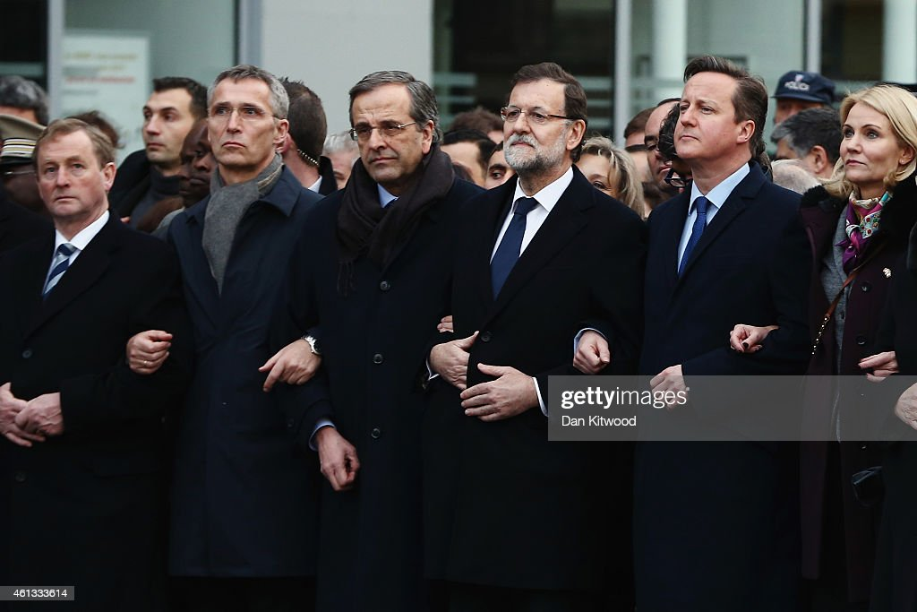 World leaders and dignitaries, including (L-R) Taoiseach of Ireland Enda Kenny, Spanish Prime Minister Mariano Rajoy and British Prime Minister David Cameron attend a mass unity rally following the recent Paris terrorist attacks on January 11, 2015 in Paris, France. An estimated one million people have converged in central Paris for the Unity March joining in solidarity with the 17 victims of this week's terrorist attacks in the country. French President Francois Hollande led the march and was joined by world leaders in a sign of unity. The terrorist atrocities started on Wednesday with the attack on the French satirical magazine Charlie Hebdo, killing 12, and ended on Friday with sieges at a printing company in Dammartin en Goele and a Kosher supermarket in Paris with four hostages and three suspects being killed. A fourth suspect, Hayat Boumeddiene, 26, escaped and is wanted in connection with the murder of a policewoman.
