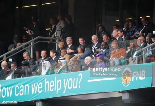 World leaders and dignitaries sit during the official memorial service for former South African President Nelson Mandela at the FNB Stadium on...