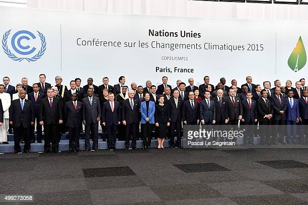 World leaders attend the Family photo session of the Cop 21 on November 30 2015 in Paris France World leaders are meeting in Paris for the start of...