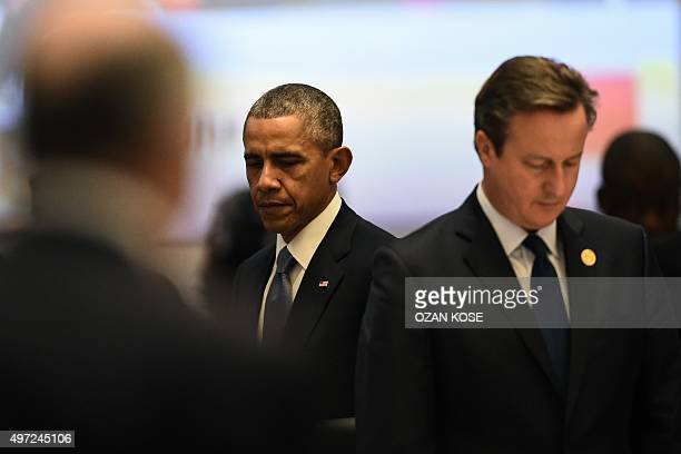 World leaders including US President Barack Obama and British Prime Minister David Cameron observe a minute of silence on November 15 2015 to...
