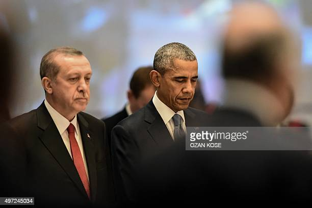 World leaders including US President Barack Obama and Turkish President Recep Tayyip Erdogan observe a minute of silence on November 15 2015 to...
