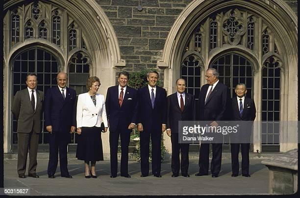 World leaders Noboru Takashita Helmut Kohl Francois Mitterand Brian Mulroney Ronald W Reagan Margaret Thatcher and Ciriaco de Mita attending Economic...