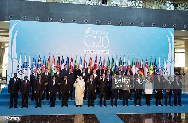 World leaders participate in a family photo during the G20 summit in Antalya Turkey November 15 2015 AFP PHOTO / SAUL LOEB