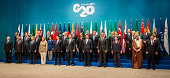 World leaders pose for the annual G20 family photograph on November 15 2014 in Brisbane Australia World leaders have gathered in Brisbane for the...