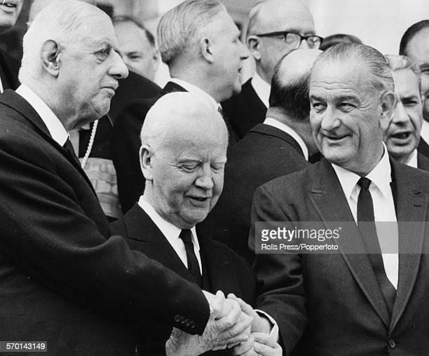 World leaders shake hands at the funeral of German statesman Konrad Adenauer French President Charles de Gaulle German President Heinrich Lubke and...