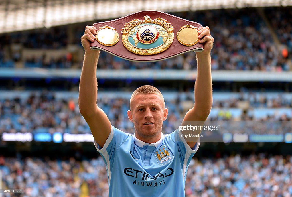 World Lightweight champion Terry Flanagan lifts the champion belt prior to the Barclays Premier League match between Manchester City and Watford at Etihad Stadium on August 29, 2015 in Manchester, England.
