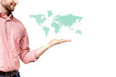 World map floating above a mans palm.