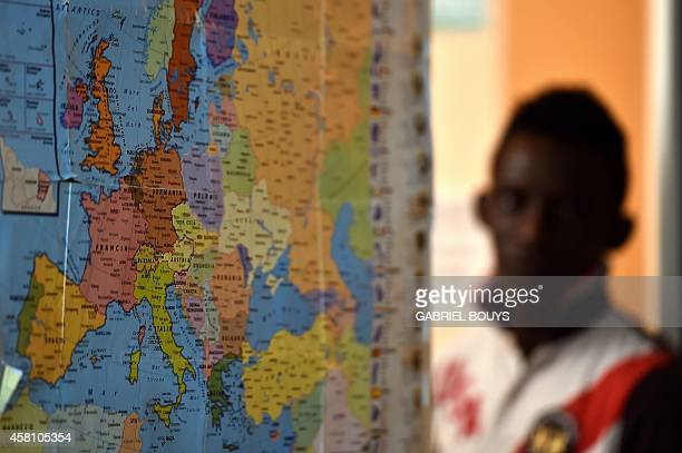 A world map is pasted on the wall of a classroom for asylum seeker at the hotel Villa Mokarta temporarily transformed in a center for immigrants on...