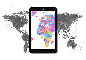 World map made with multicoloured watercolour drops on white paper