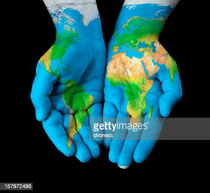 World map painted on hands : Stock Photo