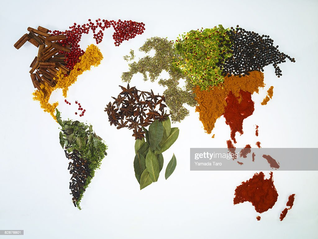 World map with spices and herbs : Stock Photo