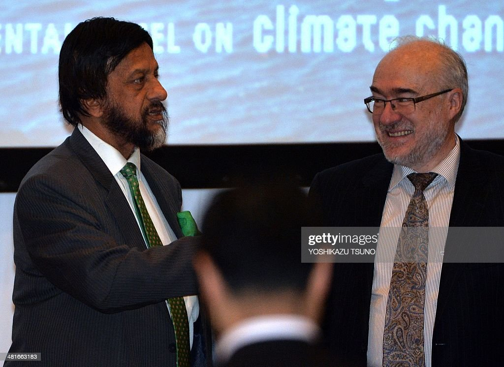 World Meteorological Organization (WMO) secretary general Michel Jarraud (R) chats with Intergovernmental Panel on Climate Change (IPCC) chairman Rajendra Pachauri (L) before a press conference after the 10th plenary of the IPCC Working Group II in Yokohama, suburban Tokyo on March 31, 2014. Soaring carbon emissions will amplify the risk of conflict, hunger, floods and migration this century, the UN's expert panel said in a landmark report on the impact of climate change. AFP PHOTO / Yoshikazu TSUNO