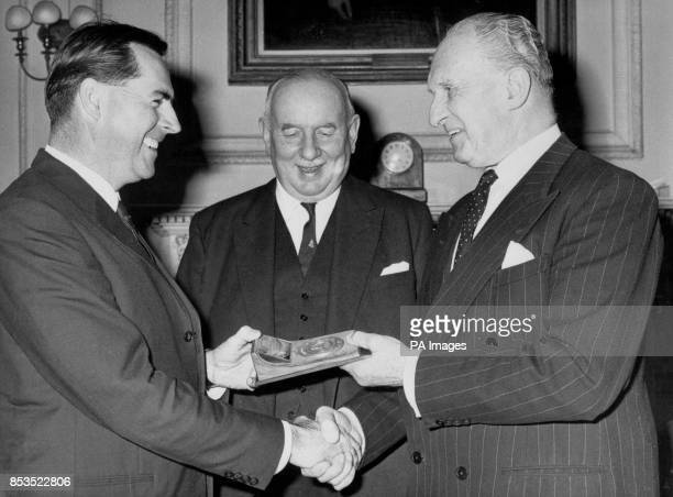 World motor racing champion Jack Brabham receiving from the Marquess Camden chairman of the Royal Automobile Club Competitions Committee a gold medal...
