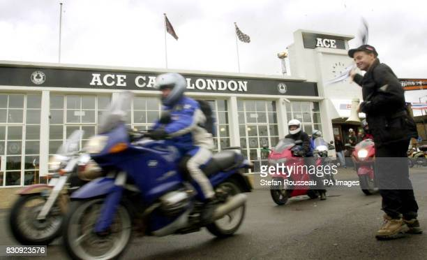 World motorcycle race organiser Nick Sanders waves off competitors in the first ever roundtheworld motorcycle race at Ace cafe in north London *...