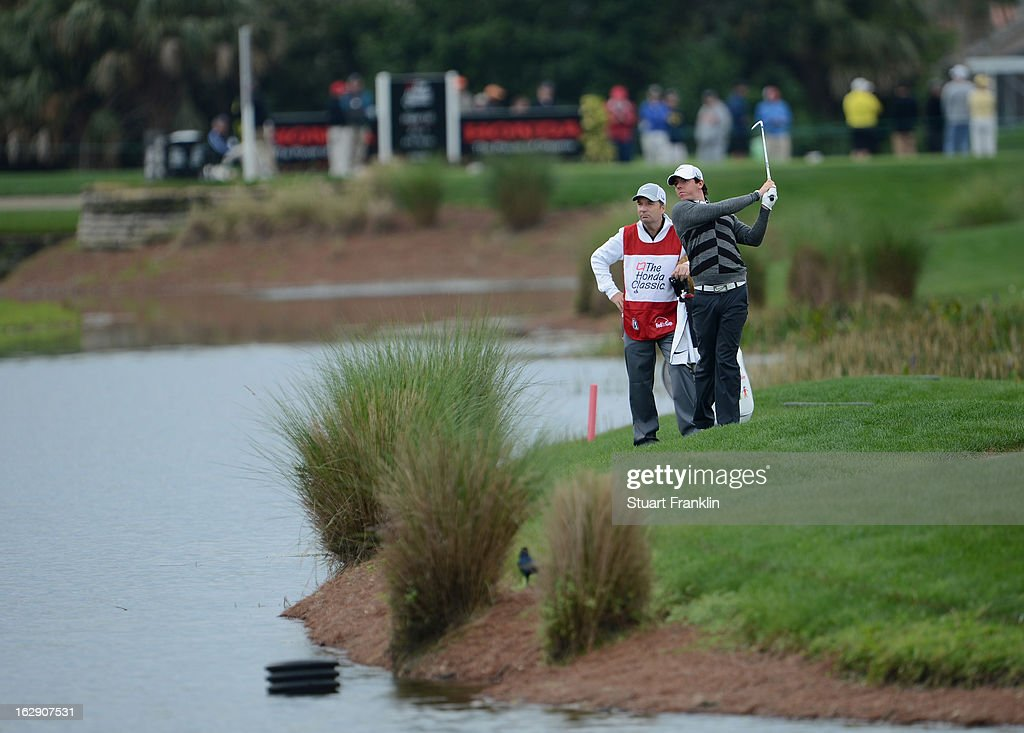 World number one and defending champion Rory McIlroy of Northern Ireland plays a shot on the 16th hole where he took a triple bogey seven during the...