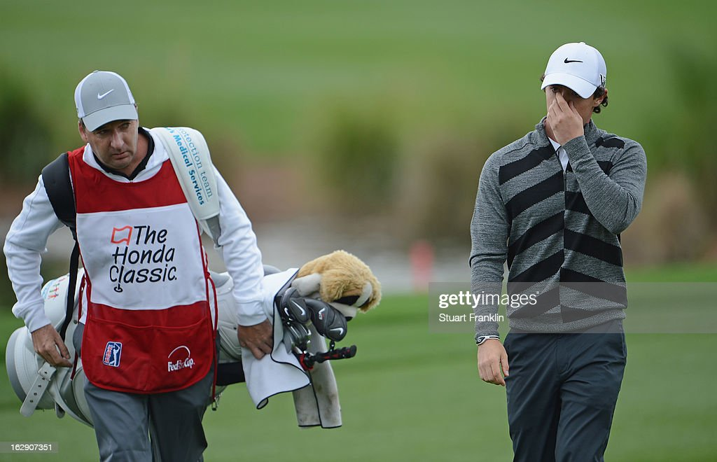 World number one and defending champion, Rory McIlroy of Northern Ireland walks off the course on the 18th hole, his nineth with caddie J.P Fitzgerald during the second round of the Honda Classic on March 1, 2013 in Palm Beach Gardens, Florida.