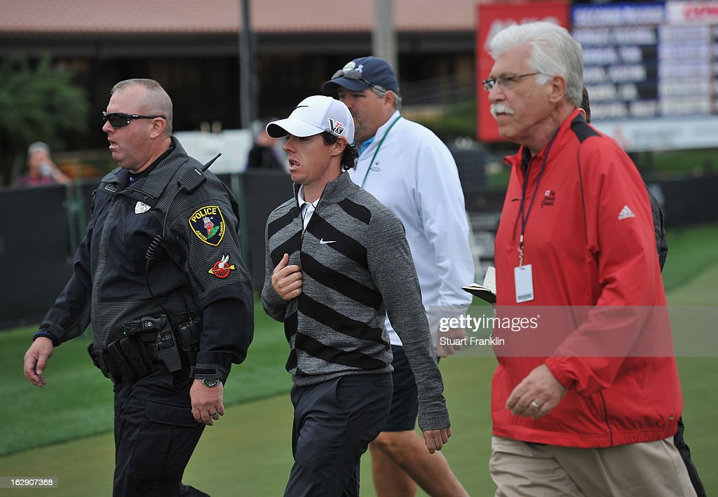 World number one and defending champion, Rory McIlroy of Northern Ireland walks off the course on the 18th hole, his nineth during the second round of the Honda Classic on March 1, 2013 in Palm Beach Gardens, Florida.
