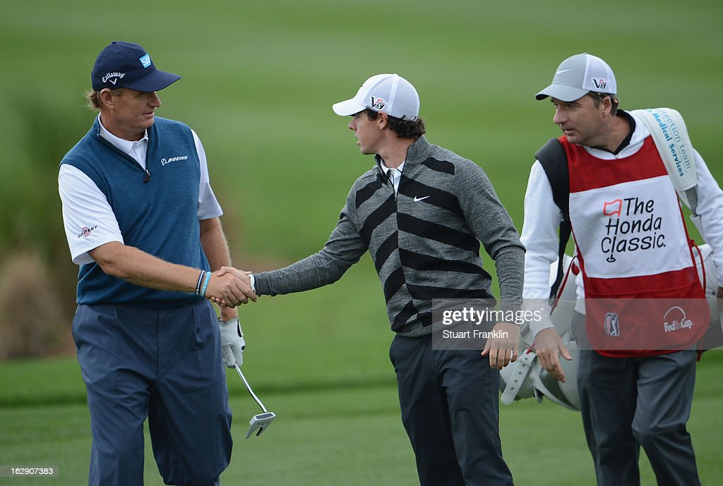World number one and defending champion, Rory McIlroy of Northern Ireland shakes hands with Open champion Ernie Els of South Africa as he walks off the course on the 18th hole, his nineth during the second round of the Honda Classic on March 1, 2013 in Palm Beach Gardens, Florida.