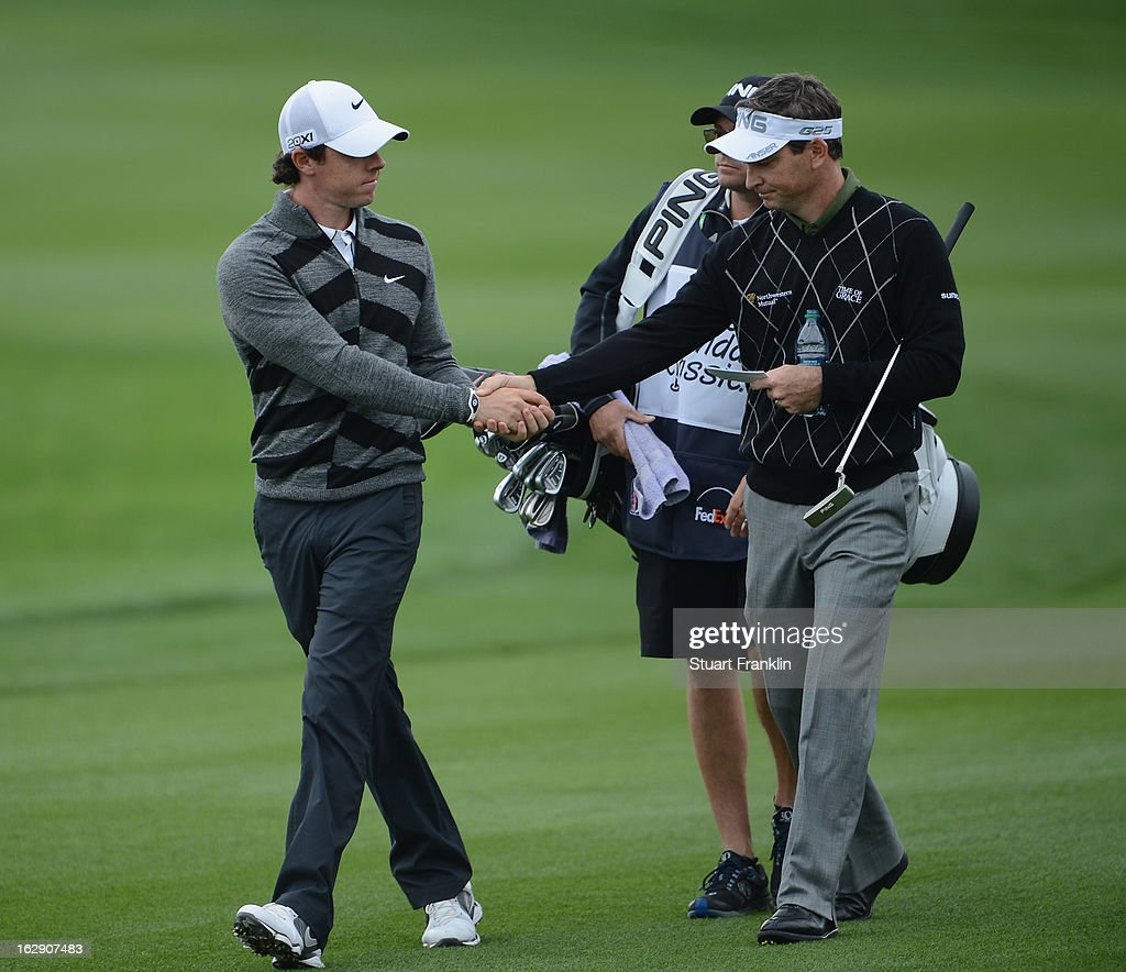 World number one and defending champion, Rory McIlroy of Northern Ireland shakes hands with Mark Wilson of USA as he walks off the course on the 18th hole, his nineth during the second round of the Honda Classic on March 1, 2013 in Palm Beach Gardens, Florida.