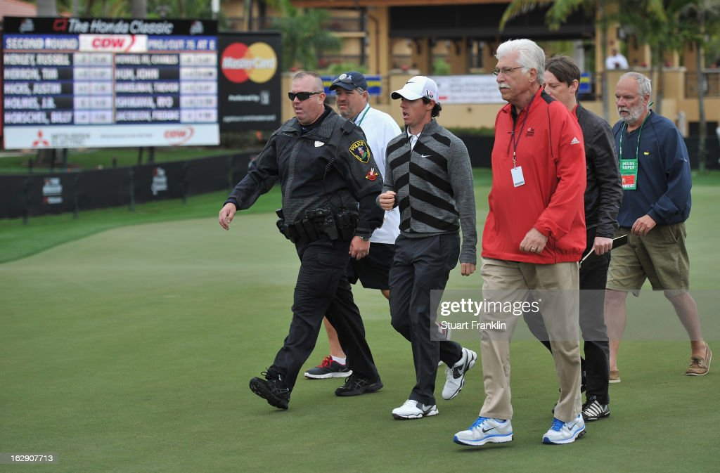 World number one and defending champion, <a gi-track='captionPersonalityLinkClicked' href=/galleries/search?phrase=Rory+McIlroy&family=editorial&specificpeople=783109 ng-click='$event.stopPropagation()'>Rory McIlroy</a> of Northern Ireland walks off the course on the 18th hole, his nineth during the second round of the Honda Classic on March 1, 2013 in Palm Beach Gardens, Florida.