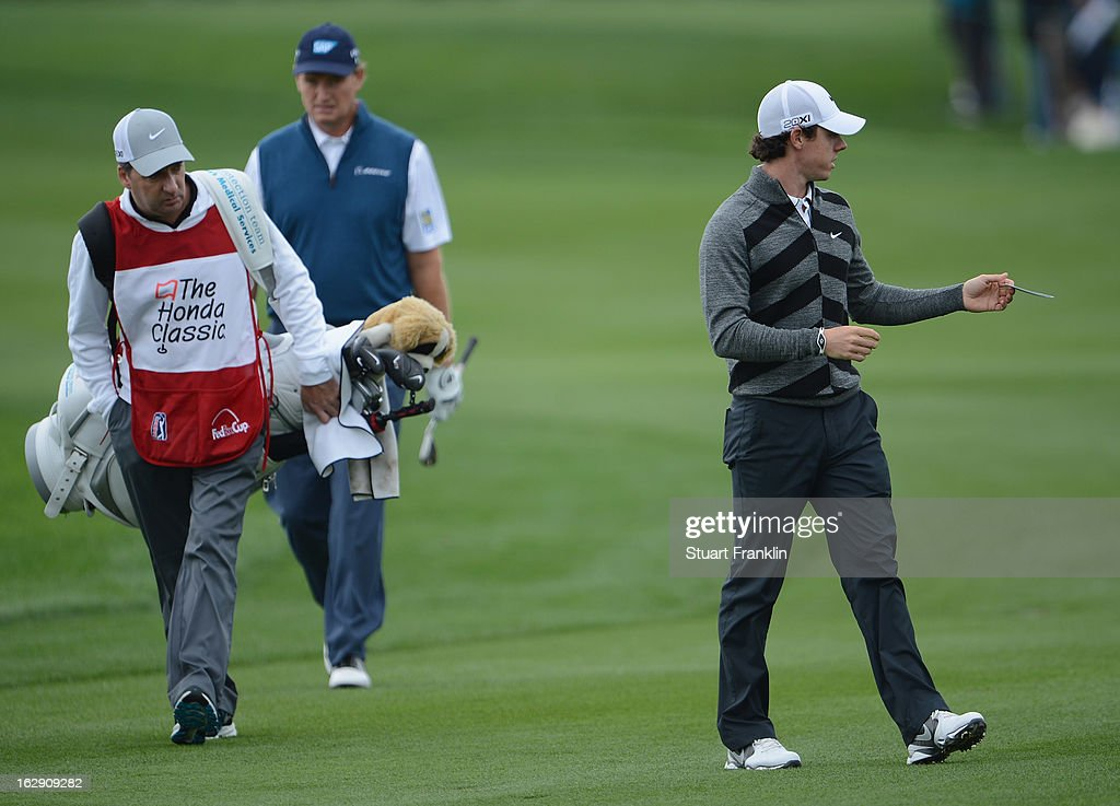 World number one and defending champion, Rory McIlroy of Northern Ireland hands over his score card as he walks off the course on the 18th hole, his nineth during the second round of the Honda Classic on March 1, 2013 in Palm Beach Gardens, Florida.