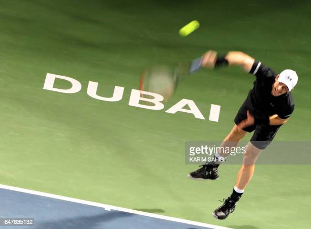 World number one Andy Murray of Great Britain returns the ball to Spain's Fernando Verdasco during their ATP final tennis match as part of the Dubai...