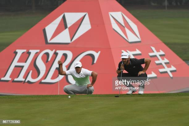 World number one Dustin Johnson of the US and compatriot Brooks Koepka line their putts during the final round of the 975 million USD WGCHSBC...