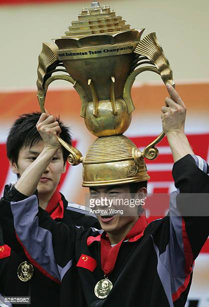 World number one Lin Dan of China puts the trophy on his head after China beat Indonesia 30 to win the 2005 Sudirman Cup World Mixed Team Badminton...
