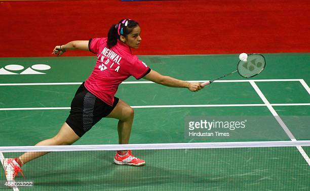 World number one player Saina Nehwal in action against Ratchanok Intanon badminton player from Thailand during the Yonex Sunrise India Open Badminton...