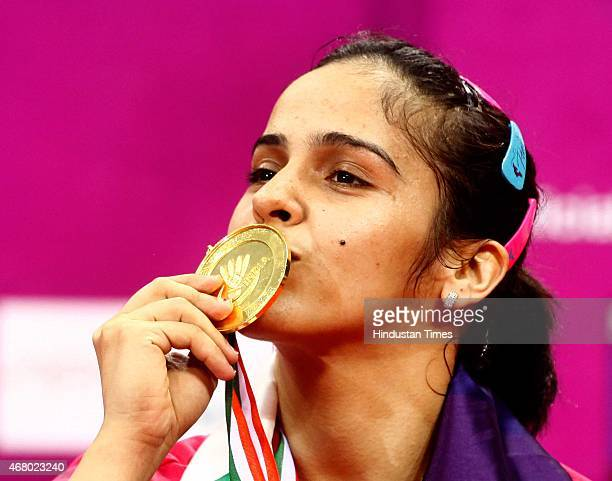 World number one player Saina Nehwal kisses her gold medal during the Yonex Sunrise India Open Badminton Championship at Siri Fort Sports Complex on...