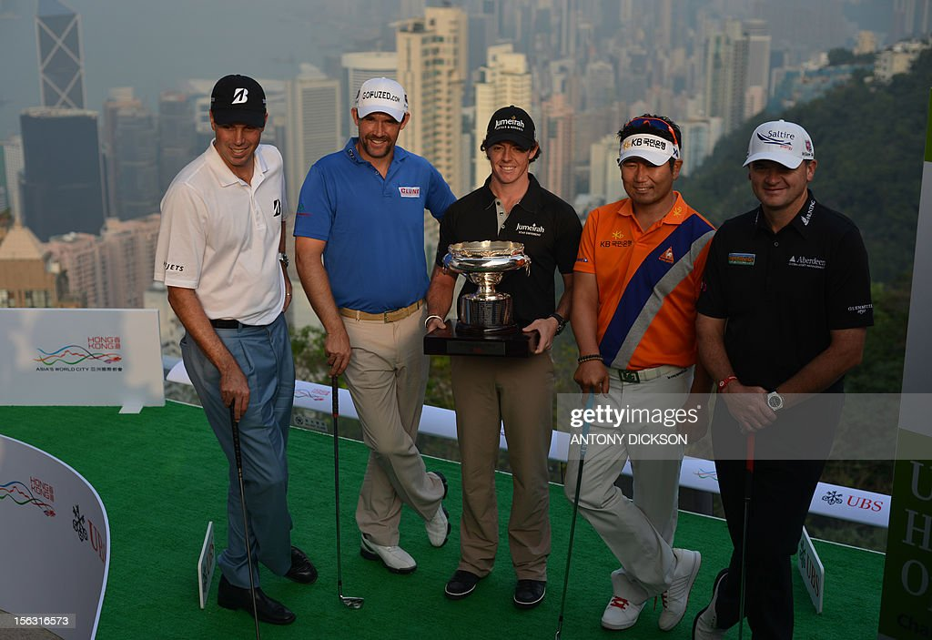 World number one Rory McIlroy of Northern Ireland (C) holds the Hong Kong Open trophy as he stands with Matt Kuchar (L) of the US, Padraig Harrington of Ireland (2nd L), Y.E. Yang of South Korea (2nd R) and Paul Lawrie of Scotland (R) during a promotion for the UBS Hong Kong Open golf tournament in Hong Kong on November 13, 2012. The tournament runs from 15 to 18 November. AFP PHOTO / Antony DICKSON