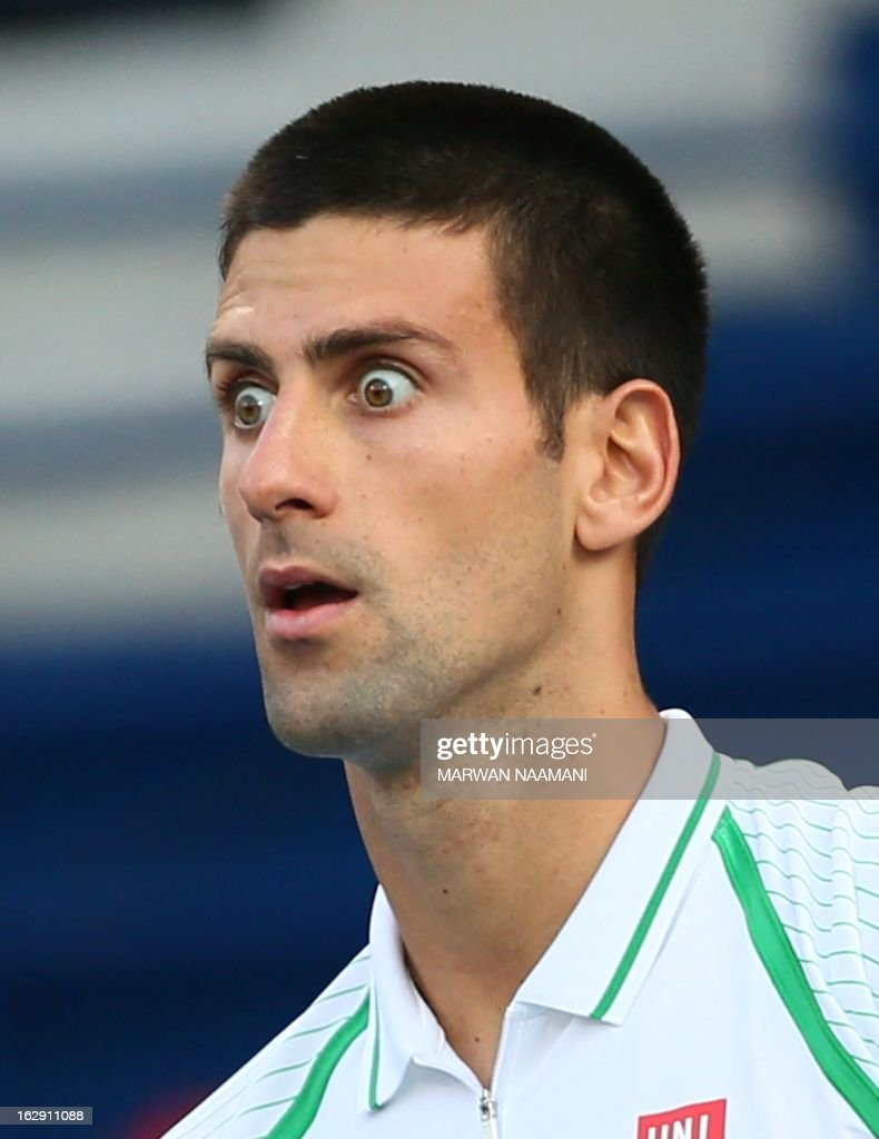 World number one Serbia's Novak Djokovic reacts during his match against Argentina's Juan Martin Del Potro in their ATP Dubai Open tennis semi-final match in the Gulf emirate on March 1, 2013. AFP PHOTO/MARWAN NAAMANI