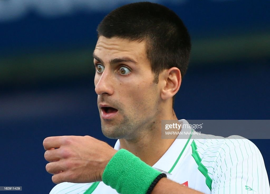 World number one Serbia's Novak Djokovic reacts during his match against Argentina's Juan Martin Del Potro in their ATP Dubai Open tennis semi-final match in the Gulf emirate on March 1, 2013.
