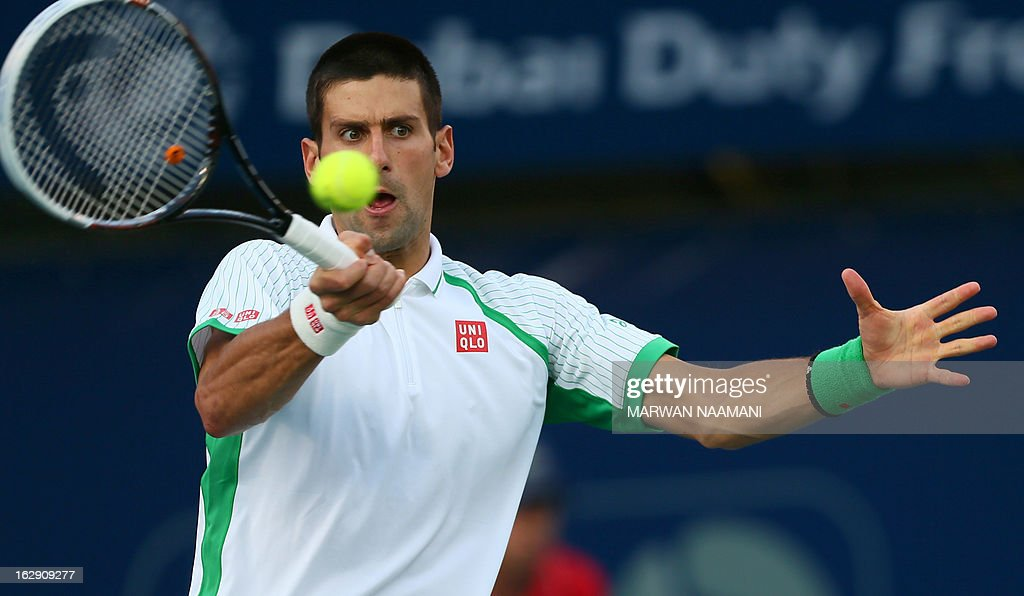 World number one Serbia's Novak Djokovic returns the ball to Argentina's Juan Martin Del Potro during their ATP Dubai Open tennis semi-final match in the Gulf emirate on March 01, 2013. AFP PHOTO/MARWAN NAAMANI