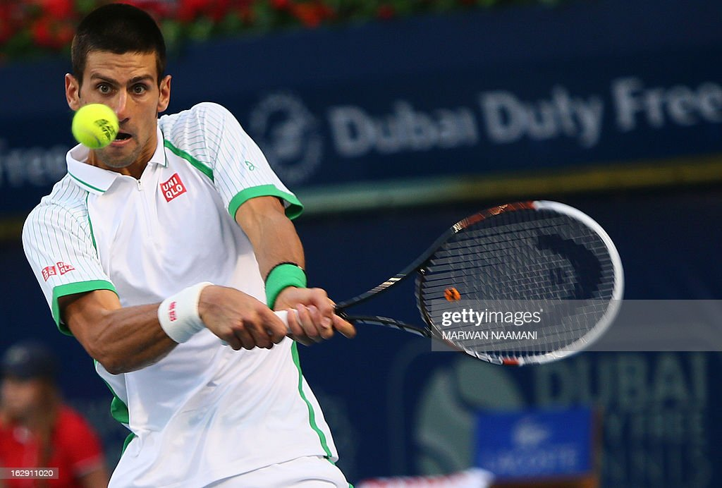 World number one Serbia's Novak Djokovic returns the ball to Argentina's Juan Martin Del Potro during their ATP Dubai Open tennis semi-final match in the Gulf emirate on March 01, 2013.