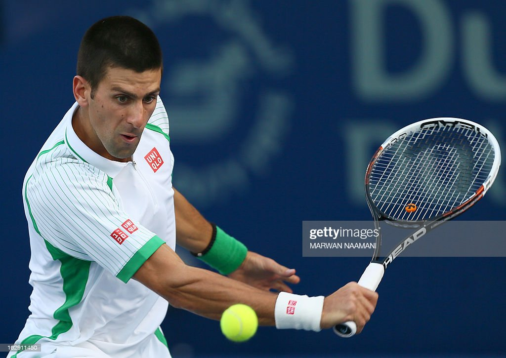 World number one Serbia's Novak Djokovic returns the ball to Argentina's Juan Martin Del Potro during their ATP Dubai Open tennis semi-final match in the Gulf emirate on March 1, 2013.