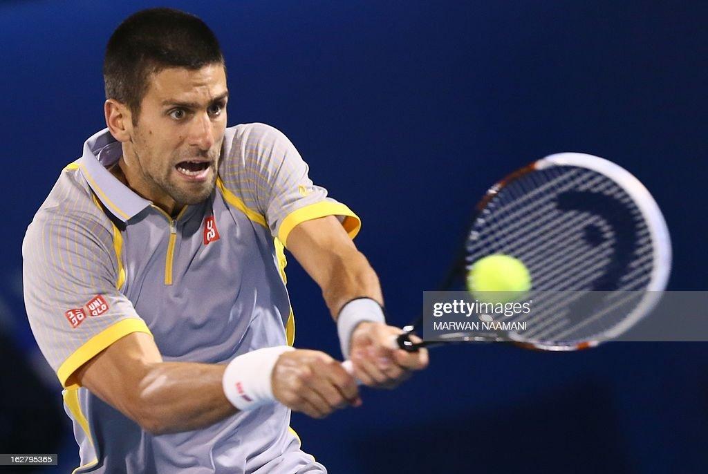 World number one Serbia's Novak Djokovic returns the ball to Spain's Roberto Bautista Agut during their ATP Dubai Open tennis match in the Gulf emirate on February 27, 2013. AFP PHOTO/MARWAN NAAMANI