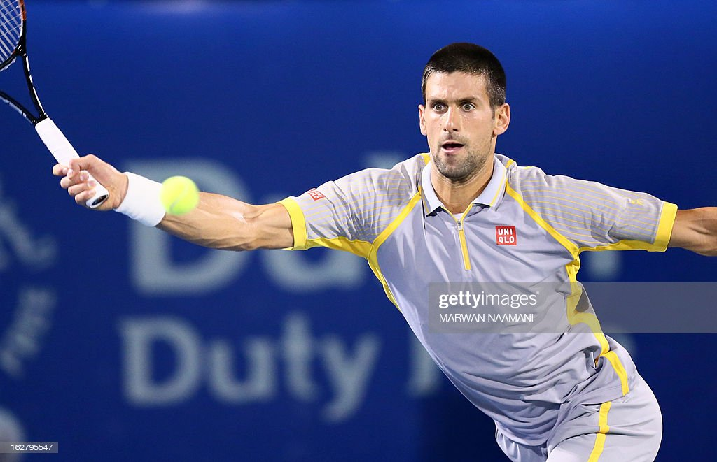 World number one Serbia's Novak Djokovic returns the ball to Spain's Roberto Bautista Agut during their ATP Dubai Open tennis match in the Gulf emirate on February 27, 2013. AFP PHOTO/MARWAN NAAMANI