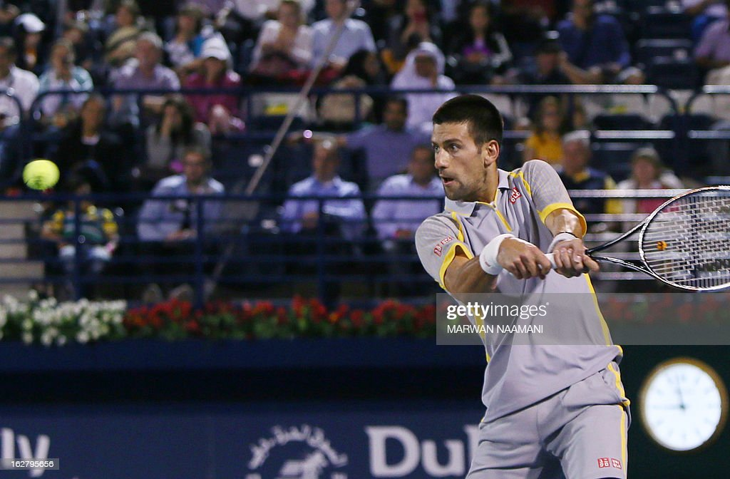 World number one Serbia's Novak Djokovic returns the ball to Spain's Roberto Bautista Agut during their ATP Dubai Open tennis match in the Gulf emirate on February 27, 2013.