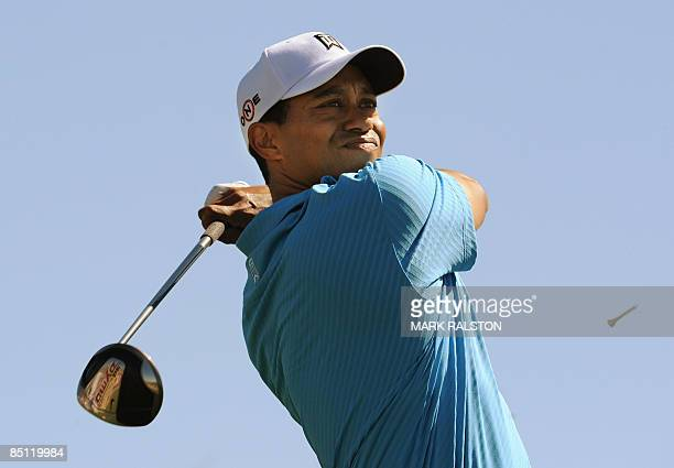 World number one Tiger Woods tees off on the 2nd hole during his matchplay game against Brendan Jones of Australia on day one of the Accenture Match...