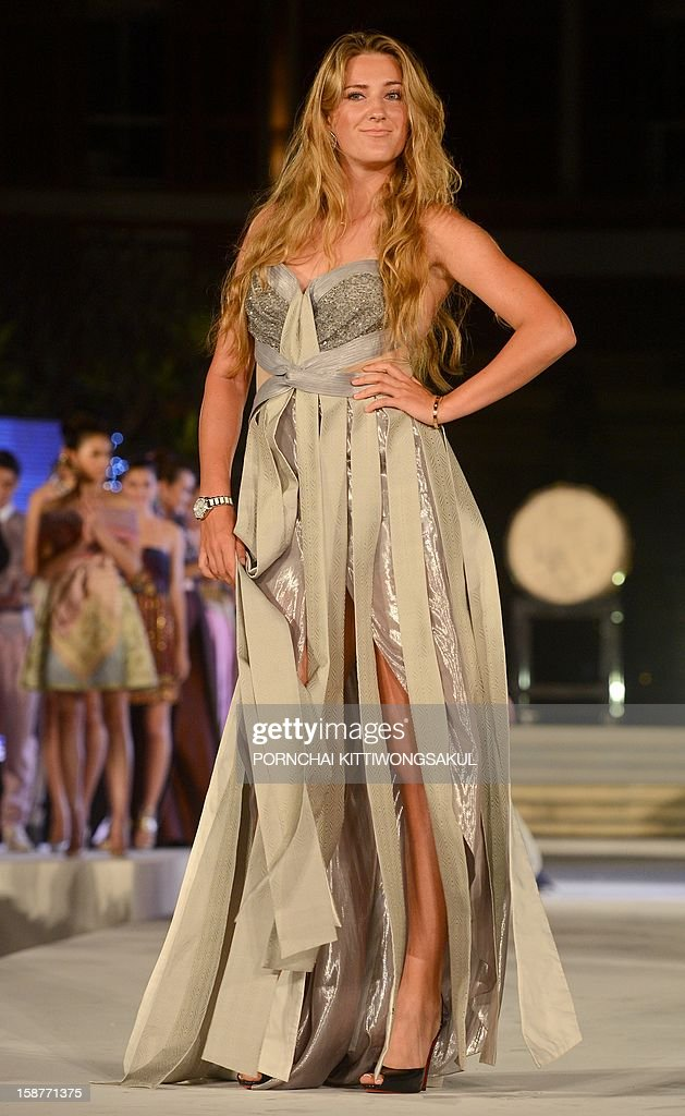 World number one woman's tennis player Victoria Azarenka of Belarus walks the cat walk during the Thai silk fashion show in Thailand's resort seaside town of Hua Hin on December 28, 2012. Azarenka will play an exhibition match with Li Na at the Hua Hin World Tennis Invitation on December 29.