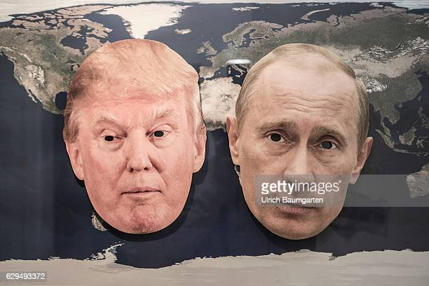 World Policy Symbol photo with the masks of Donald Trump and the Russian President Vladimir Putin on a world map