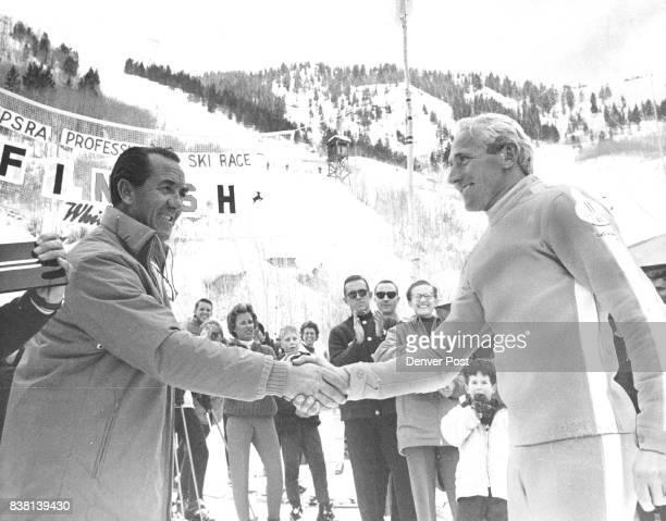 FEB 11 1962 ***** World Professional Ski Championship Friedl Pfeifer president of the International Professional Ski Racing Assn congratulates...