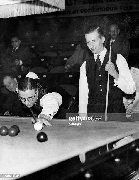 World Professional Snooker Champioships held at Thurston's Hall in Leicester Square London Fred Davis at the table taking a shot watched by his...