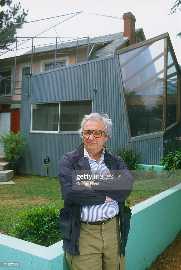 World renowned architect <a gi-track='captionPersonalityLinkClicked' href=/galleries/search?phrase=Frank+Gehry&family=editorial&specificpeople=131842 ng-click='$event.stopPropagation()'>Frank Gehry</a> poses for a 1988 portrait in front of his Santa Monica, California home. Gehry is considered the leading voice of the 'deconstructivist' movement of architecture. He has created hundreds of designs including the Walt Disney Concert Hall in Los Angeles, California.