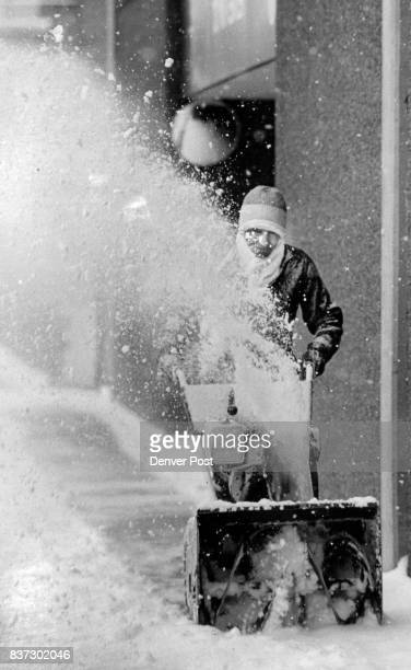 World renowned snow blower and maintenance man Alfredo Martinez uses his machine to blow the dusting of snow from the sidewalks of the Denver...