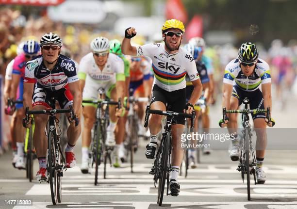 World Road Race Champion Mark Cavendish of Great Britain and SKY Procycling celebrates winning stage two of the 2012 Tour de France from Vise to...