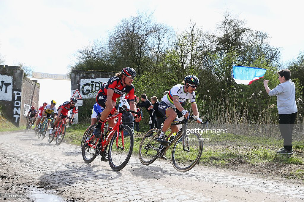 World Road Race Champion <a gi-track='captionPersonalityLinkClicked' href=/galleries/search?phrase=Peter+Sagan&family=editorial&specificpeople=4846179 ng-click='$event.stopPropagation()'>Peter Sagan</a> of Slovakia and Tinkoff rides with <a gi-track='captionPersonalityLinkClicked' href=/galleries/search?phrase=Daniel+Oss&family=editorial&specificpeople=5734271 ng-click='$event.stopPropagation()'>Daniel Oss</a> of Italy and the BMC Racing team during the 2016 Paris- Roubaix from Compiegne to Roubaix on April 10, 2016 in Paris, France. The 114th edition race will be held over 257km and 27 sectuers of cobbles.