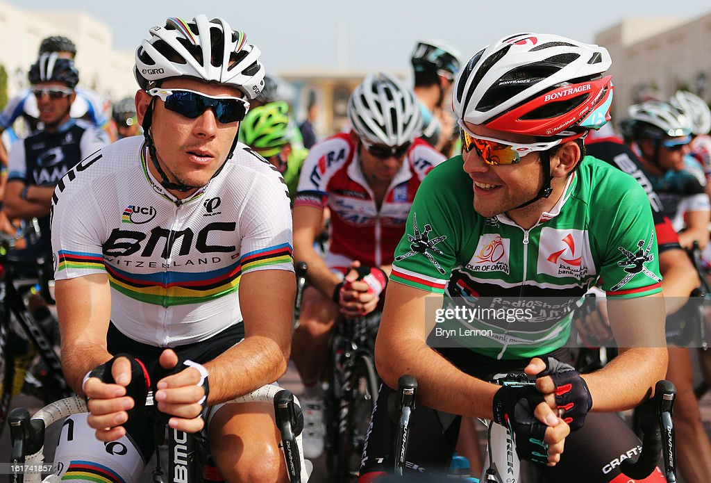 World Road Race Champion <a gi-track='captionPersonalityLinkClicked' href=/galleries/search?phrase=Philippe+Gilbert&family=editorial&specificpeople=578487 ng-click='$event.stopPropagation()'>Philippe Gilbert</a> chats to <a gi-track='captionPersonalityLinkClicked' href=/galleries/search?phrase=Tony+Gallopin&family=editorial&specificpeople=6712360 ng-click='$event.stopPropagation()'>Tony Gallopin</a> of France and Radioshack Leopard ahead of the start of stage five of the Tour of Oman from Al Alam Palace to the Ministry of Housing in Boshar on February 15, 2013 in Boshar, Oman.